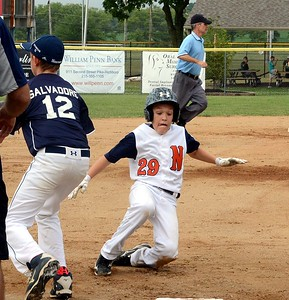 Northampton's Chris Nowmos slides safely into third base.
