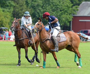Victoria Halliday and Talha Chaudhry battle for possession.