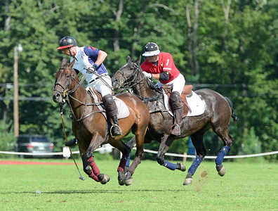 Barclay Knapp races Gary Hulton to the ball at a polo match held recently at Tinicum Polo Club, Upper Black Eddy, Pa. (John Gleeson – 21st-Century Media)