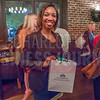 Leticia Foster, winer of the drawing at the NextGenCLT:Pivot event held at Olde Mecklenburg Brewery.