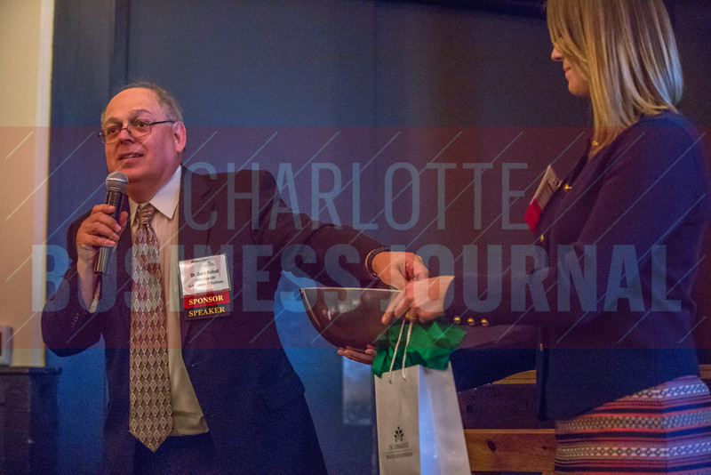 Dr. Gary Kohut, Division Director at AccruePartners, draws a name from attendees of the NextGenCLT:Pivot event held at Olde Mecklenburg Brewery to receive a prize.