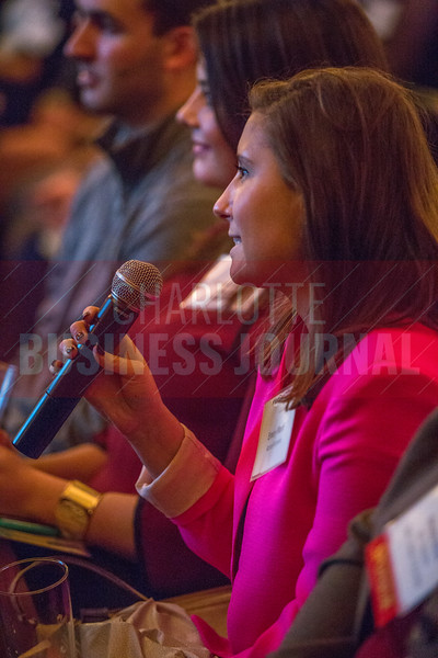 Attendees of the NextGenCLT:Pivot event held at Olde Mecklenburg Brewery ask questions during the Q&A session.