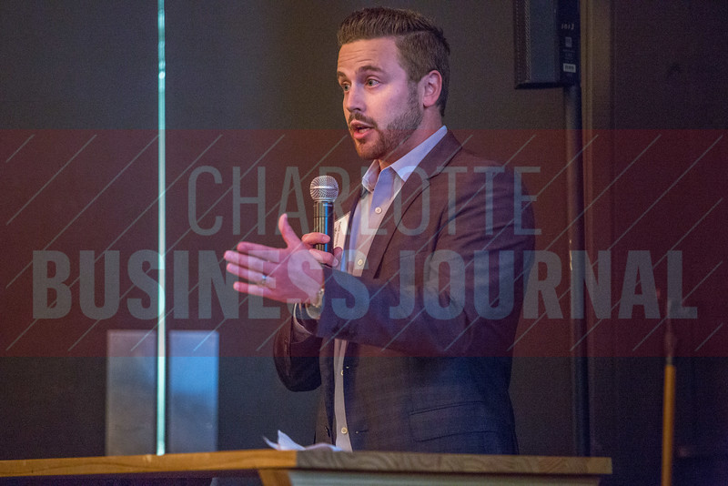 TJ McCullough, Advertising Director at Charlotte Business Journal, kicks off the NextGenCLT:Pivot event held at Olde Mecklenburg Brewery.
