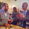 Attendees of the NextGenCLT:Pivot event held at Olde Mecklenburg Brewery begin to arrive and network.