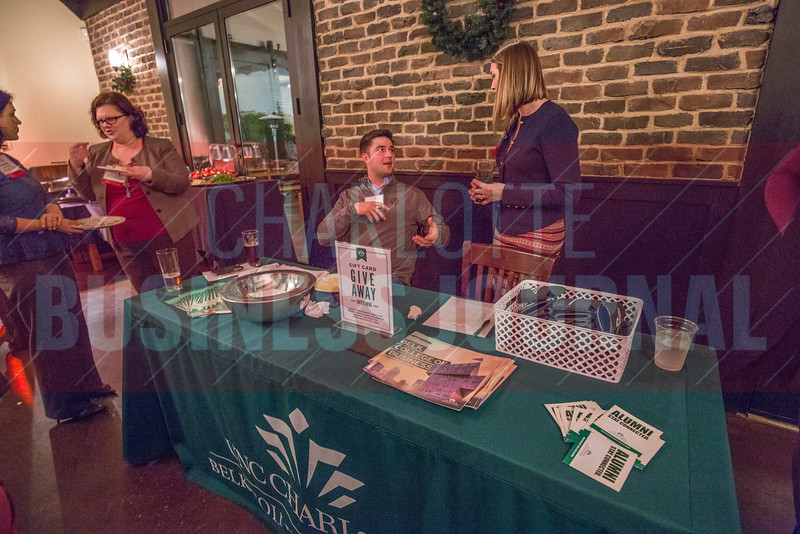 UNC Charlotte: Belk College Of Buisness table at the NextGenCLT:Pivot event held at Olde Mecklenburg Brewery.