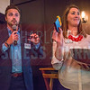 TJ McCullough, Advertising Director at  Charlotte Business Journal (left) and Samantha Story of the Belk College of Business (right) draw names for a giveaway during Charlotte Business Journal's NextGen event, held at Olde Mecklenburg Brewery.