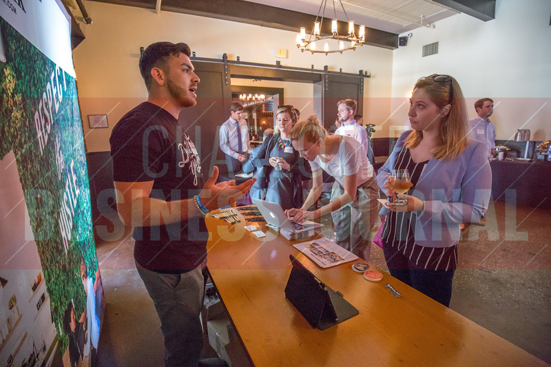 WeWork booth at Charlotte Business Journal's NextGen event, held at Olde Mecklenburg Brewery.