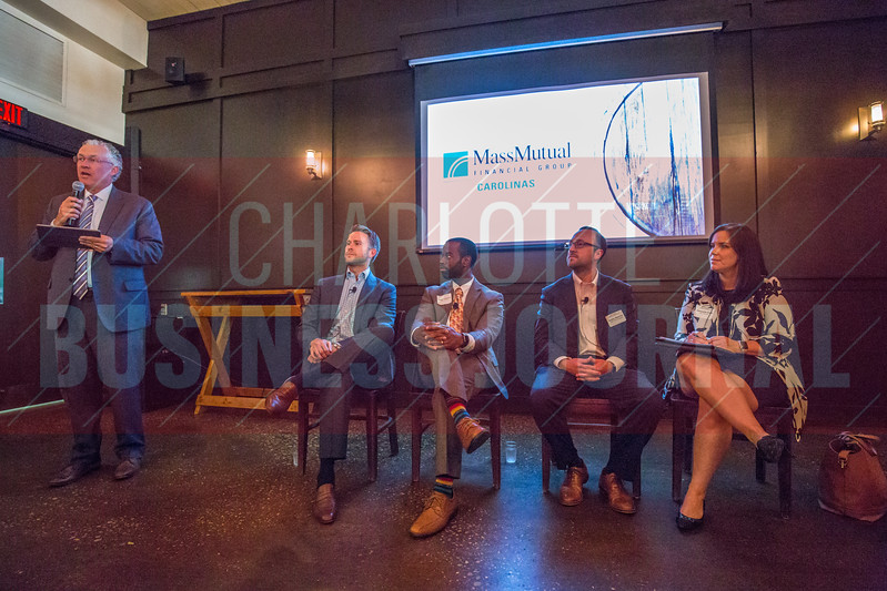 Tim Flanagan, President of MassMutual Carolinas (left), speaks before Charlotte Business Journal's NextGen event.