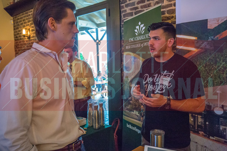 WeWork booth at Charlotte Business Journal's NextGen event, held at Olde Mecklenburg Brewery.