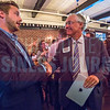 TJ McCullough, Advertising Director at  Charlotte Business Journal (left), shakes hands with Tim Flanagan, President of MassMutual Carolinas (right) after the Charlotte Business Journal's NextGen event, held at Olde Mecklenburg Brewery