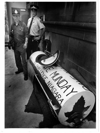 Niagara Falls, Stunters, Dave Munday - Special constable Paul Kenney with Niagar parks police and Terry Willick of Coast Line Towing stand with confiscated barrel. Lisa Massey photo 9/26/1987
