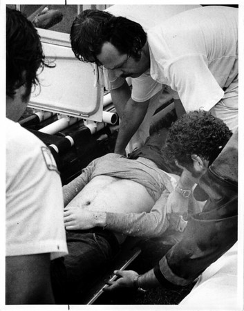 Niagara River - Raft Ride<br /> Deceased being placed in ambulance.<br /> Photo - By Dan Shunsda - 8/29/1975.
