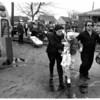 Accidents - Auto<br /> Accident involving a car and a school bus at the corner of Hyde Park and Ferry Ave.<br /> From left to right Officer Jan Dalporto, Rochelle Adkins ( years old, and Advanced EMT - Tom Howes of Professional Ambulance.<br /> Photo - By James Neiss - 3/19/1988.