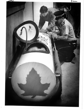 Niagara Falls, Stunters, Dave Munday - 9/28/1987 - Dave Munday, left, signs papers to release his barrel at Niagara Parks Police Station, NF, Ontario. Lisa Massey Photo.