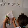 Girl copies English lesson from board in school, Las Camelias, Nicaragua.