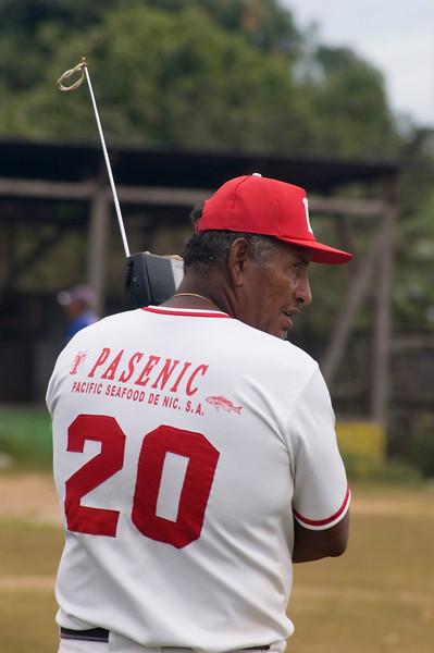Baseball player listens to national game on radio, Pearl Lagoon (Laguna de Perlas), Nicaragua.
