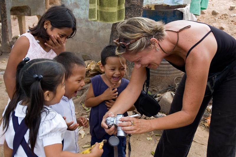 Traveler shows children digital camera photo, Las Camelias, Nicaragua.