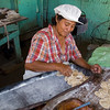 Woman prepares pastries for frying in home bakery, La Prusia, Nicaragua.