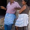 Man and woman wearing ruffled aprons at the market, Granada, Nicaragua.