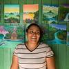 Primitivist painter Etelvina Mejia displays her paintings, Solentiname, Nicaragua.