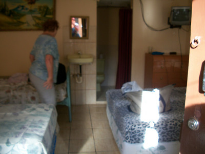 WHERE TO STAY??  **Hospedaje LIDIA (2-563-3477 / 8-947-0011) WiFi, TV (SOMETIMES there is MAYBE 1 show in English), fan.  You can purchase breakfast.  RATES:  $10/pp w/shared bathroom.  Private bathroom - $15/1, $23/2) - OWNER•MANAGER:  Manager-Maritza, Owner-Lidia LOCATION:  From the gas station (I THINK it's now Uno [it was Texaco]) on the West side of the road (across the street from where you get off the buses from CR) - at that corner turn West-Right (going into Centro) & she's a few doors down (last time I was there it was a peach colored non-descript building).  (this is where I STAY when I'm just wanting a quick overnight Visa turn-around!!)  Room for 1-7 (5 beds - 2 Doubles & the other twins) with private bathroom (last room on your left [where I stayed my 2nd trip])