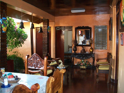 WHERE TO STAY??  **Hospedaje LIDIA (2-563-3477 / 8-947-0011) WiFi, TV (SOMETIMES there is MAYBE 1 show in English), fan.  You can purchase breakfast.  RATES:  $10/per PERSON w/shared bathroom.  Private bathroom - $15/1, $23/2) - OWNER•MANAGER:  Manager-Maritza, Owner-Lidia.  They do not speak English so don't try. LOCATION:  From the gas station (I THINK it's now Uno [it was Texaco]) on the West side of the road (across the street from where you get off the buses from CR) - at that corner turn West-Right (going into Centro) & she's a few doors down (last time I was there it was a peach colored non-descript building).  (this is where I STAY when I'm just wanting a quick overnight Visa turn-around!!)  Guest sitting area