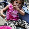 DSC07788 David Scarola Photography, Girl eating in the street in Chinandega, Nicaraguan Girl, web