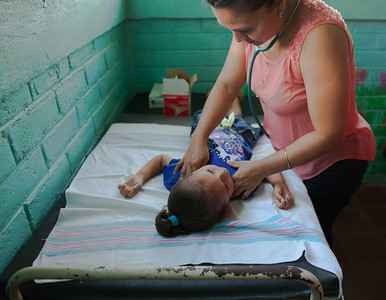 Dr. Gutierrez examines a young girl brought into the clinic.