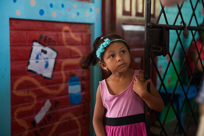 This little girl just finished seeing the doctor and is waiting for her mother so she can go play.