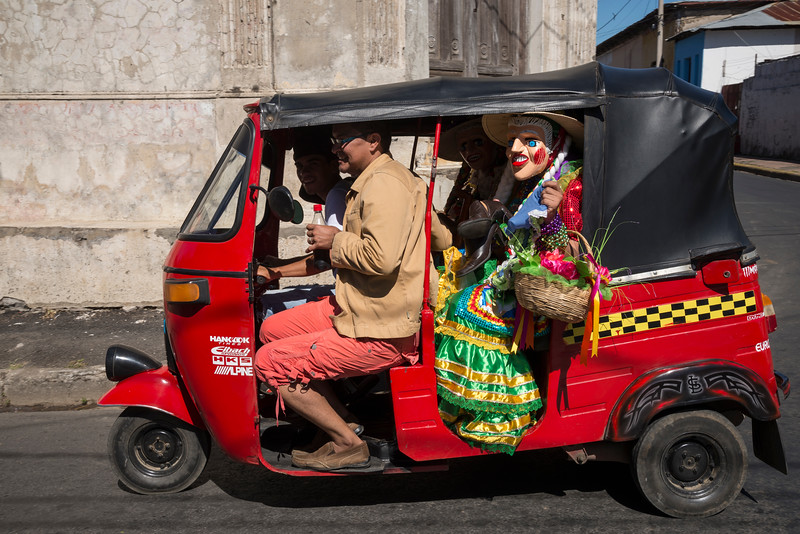 Mototaxi leaving the Feast of Saint Sebastian festival, Diriamba, Nicaragua