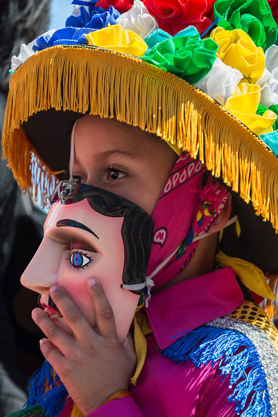Young girl lowers mask at the Feast of Saint Sebastian festival, Diriamba, Nicaragua