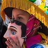 Young girl lowers mask at the Feast of Saint Sebastian festival, Diriamba, Nicaragua