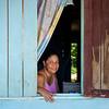 Woman in window, Little Corn Island, Nicaragua