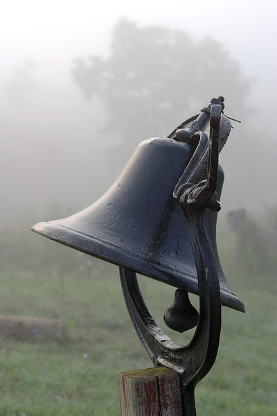 An old iron bell and fog.