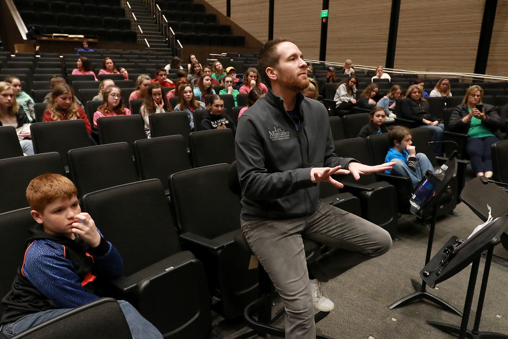 . Nick Cartell, currently playing Jean Valjean in Les Misérables on Broadway, tought a master class to the Pepperell Community Arts program on Thursday at noon at the Performing Arts Center at North Middlesex Regional High School. Cartell gives some pointers to the students as they sing during his class. SENTINEL & ENTERPRISE/JOHN LOVE