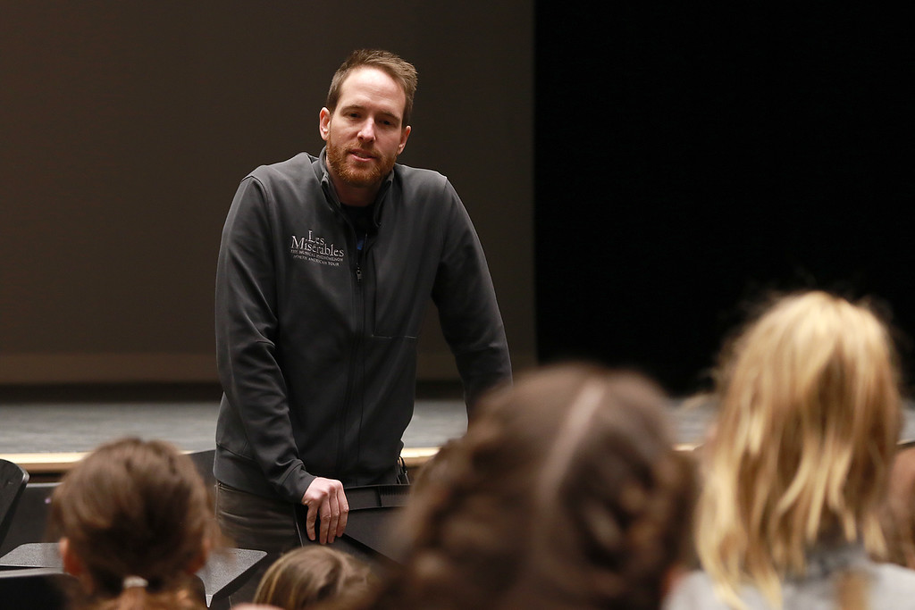 . Nick Cartell, currently playing Jean Valjean in Les Misérables on Broadway, tought a master class to the Pepperell Community Arts program on Thursday at noon at the Performing Arts Center at North Middlesex Regional High School. Students listen to him during his class. SENTINEL & ENTERPRISE/JOHN LOVE