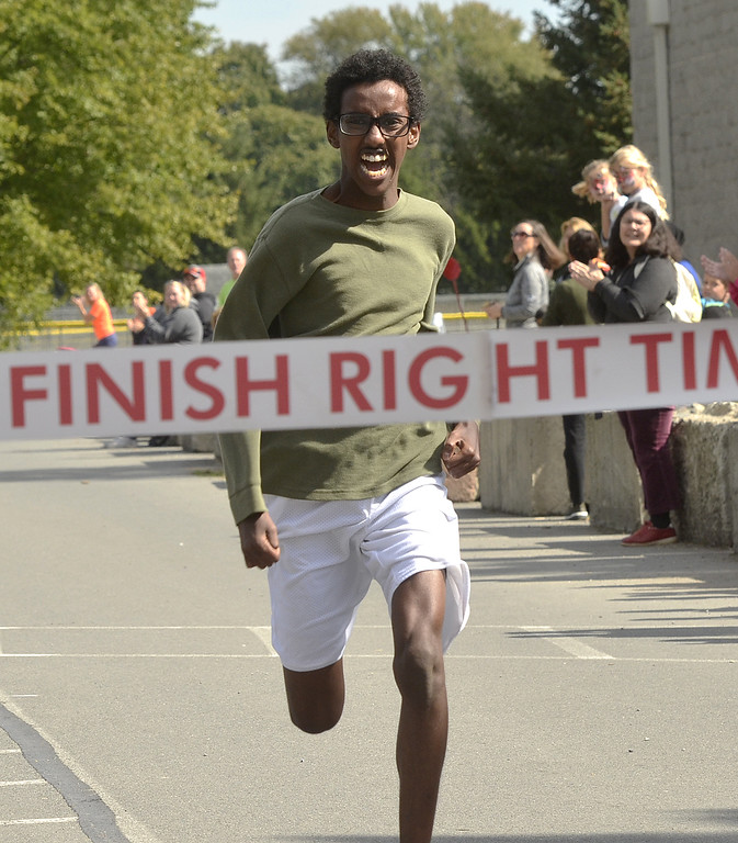 . Elmi Abdallah of Clifton Park powers through the finish line as the top male finisher at Sunday\'s Nick\'s 5k Run to be Healed at the Clifton Common.