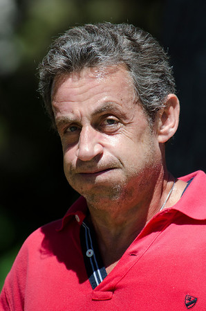Nicolas Sarkozy Runs during a Hot Day