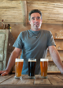 Andre and his home brewed ales at Two Goats Deli