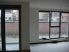 Living, zicht op ramen & terras