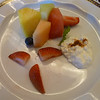 Melon and pineapple wedges with fruit and cinnamon cottage cheese