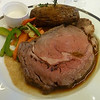 Prime rib au jus with baked potato and vegetable medley