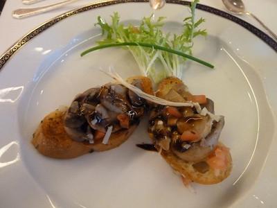 Grilled four mushroom crostini