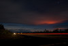 Old Volcano Rd and Volcano Hi. Red glow on clouds is from Pu'u O'o on Kilauea Volcano