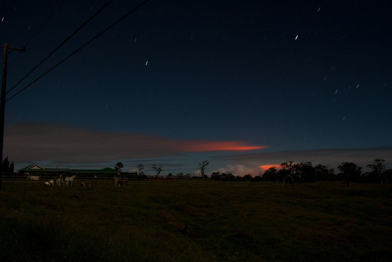 Back end of Wright Rd. Red glow on clouds is from Pu'u O'o on Kilauea Volcano