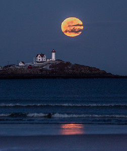 Super Moon at the Nubble - vertical with clouds