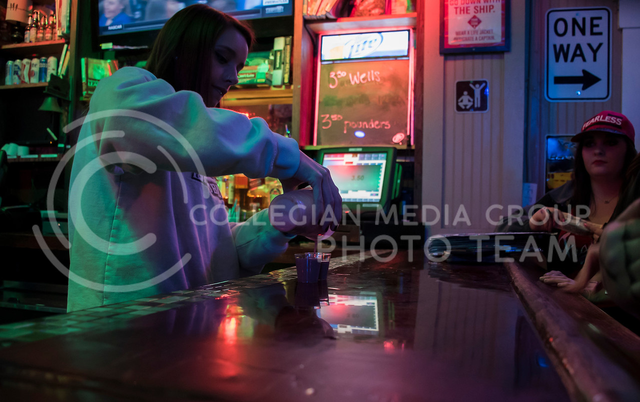 The bartender makes a special kind of shot for students partying at House Party, located in Johnny Kaws in Manhattan, KS, on Nov. 3, 2017. (Olivia Bergmeier | Collegian Media Group)