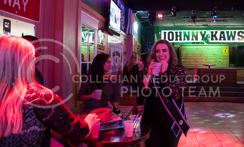 A student takes a sip at House Party located within Johnny Kaws in Manhattan, KS, on Nov. 3, 2017. (Olivia Bergmeier | Collegian Media Group)