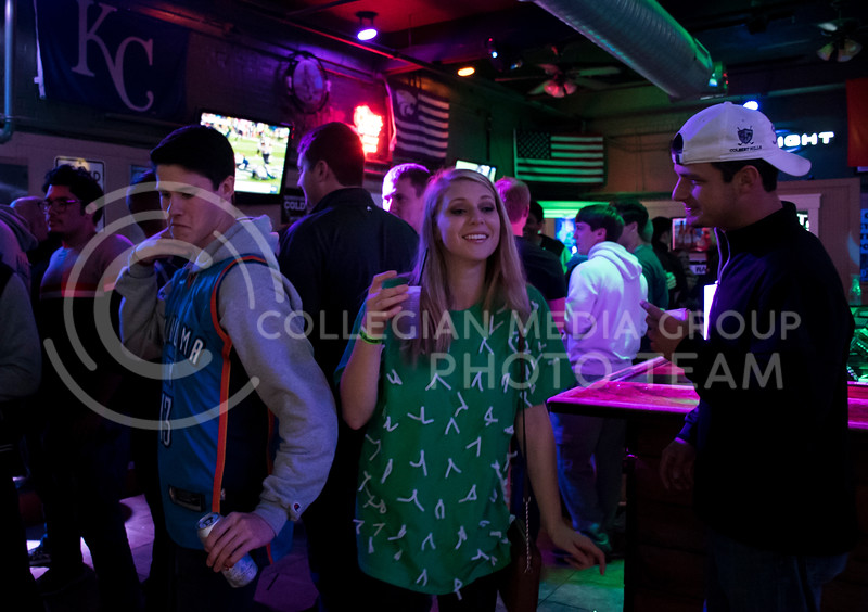 Students party near the bar at House Party, located in Johnny Kaws in Manhattan, KS, on Nov. 3, 2017. (Olivia Bergmeier | Collegian Media Group)