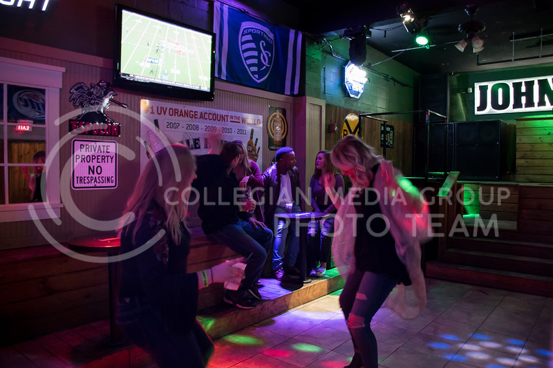 Two students dance a long to the beat at House Party located in Johnny Kaws in Manhattan, KS, on Nov. 3, 2017. (Olivia Bergmeier | Collegian Media Group)